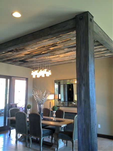 Reclaimed lumber ceiling and beam define dining room area; St. George Parade of Homes {favorites}