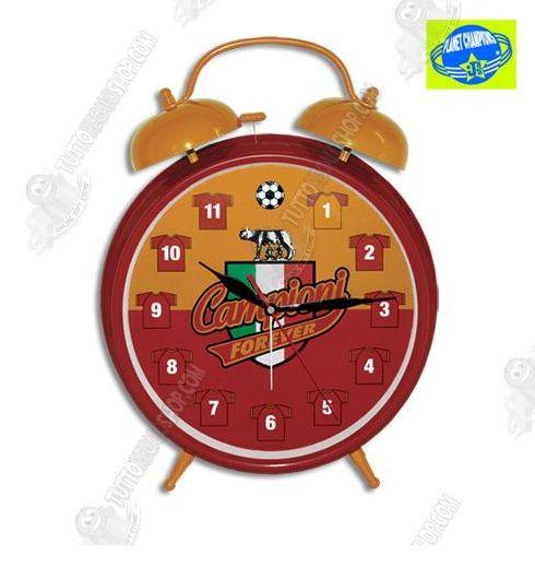 Vieni a visitare http://www.tuttoregaloshop.com per trovare tanti gadget della tua squadra del cuore. Che risveglio con la SvegliaSuper - #roma, con il suono dei colori della tua #squadra del cuore la giornata comincia con una marcia in più. La sveglia è di grandi dimensioni, il quadrante presenta l'immagine del campo di calcio e al posto dei numeri vi sono raffigurate le magliette della squadra.  #sport   #calcio   #roma   #tuttoregaloshop