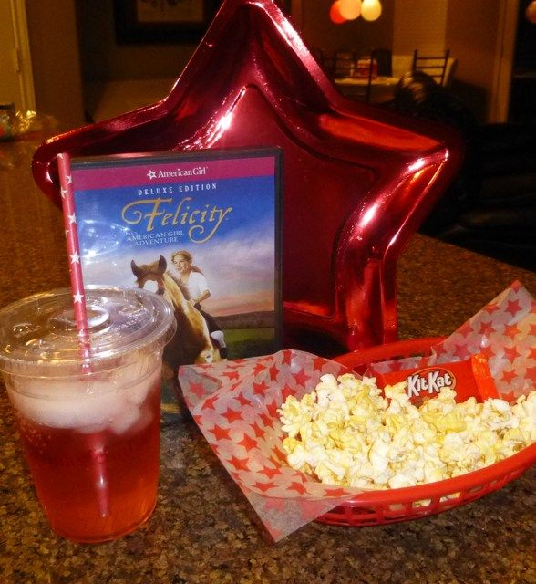 The girls watch Felicity.  Movie popcorn, kit kat & pink lemonade.