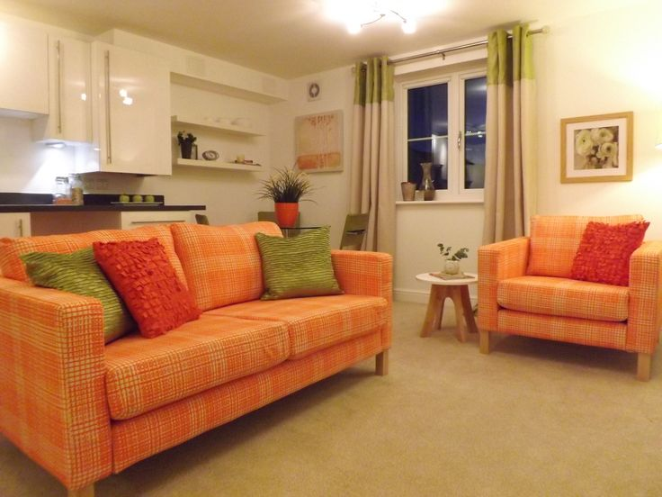 Zingy Orange Sofa With Green Accents