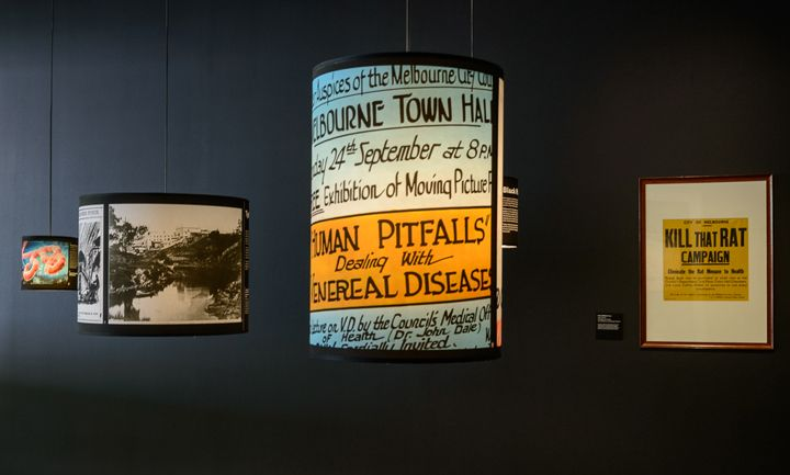 Going Viral Exhibition  Presenting an exhibition of disease to the general public is a tricky brief. In order to communicate the rich variety and history of these maladies, and how it has impacted upon Melbourne, a more lateral approach was taken. Each disease has been represented by a lampshade within the space, using the metaphor of light to express the information in a positive way. The windows featured a circular ring of light (courtesy of a simple fluorescent ring).
