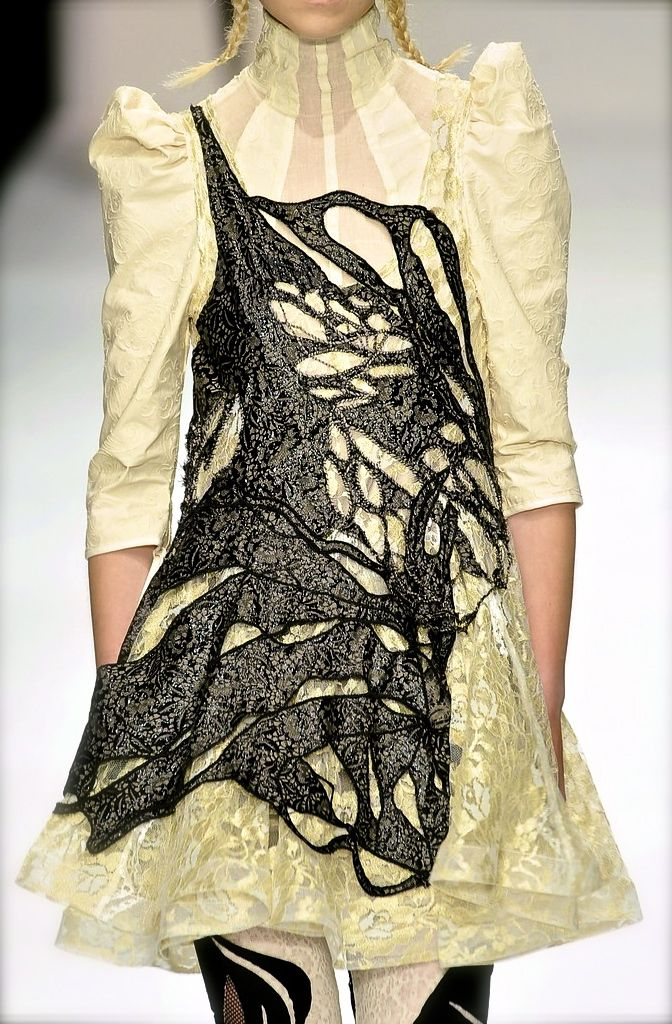 Bora Aksu S/S 2010   (looks like she walked through a giant black spider web)