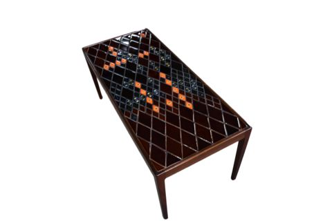 A rosewood coffee table with decorative tiles by Bjørn Wiinblad