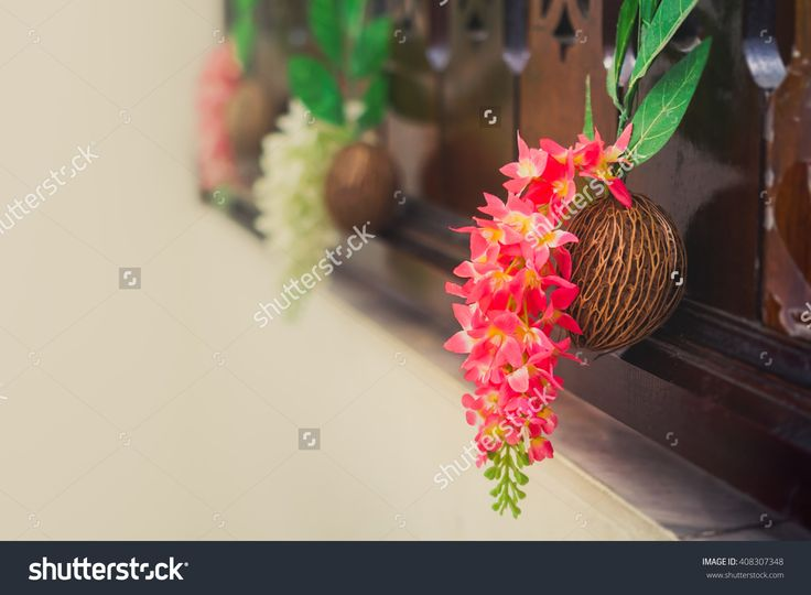 Beautiful spring bouquet of orchids on the dried Pong pong seeds (commonly known as Othalanga, Suicide tree, Buddha palm plant and Cerbera odollam).