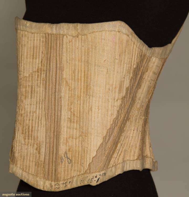 """Homespun linen, hand woven hemp or other plant fiber lining, baleen stays, corset top & bottom edges faced in .75"""" white doe skin, hand embroidered CB eyelet holes, B 31"""", W 27"""", CFL 12"""", (large, light stains, some tiny rust stains, outside linen worn away in several tiny spots) very good. BROOKLYN MUSEUM"""
