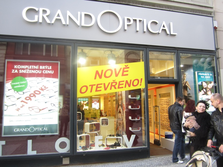 Seriously Grand Optical? You take the well designed multi market retail interior (ivory serenity and order; not bad at all), then get your buddy the printer (pretty sure his name is Honza) to add his home made posters and promo dress in store, then work his magic on the windows.  FYI a fantastic interior + terrible retail comms = terrible retail overall. TRY AGAIN