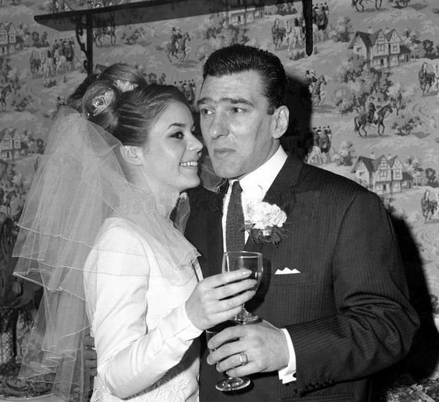 Cheers! Frances & Reggie Kray toast their marriage in 1965. Photo by David Bailey.