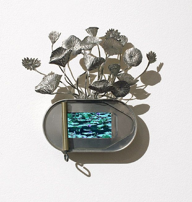 "Fiona Hall ""Breathing in the Afterlife"" (2009/2011) tin, video 21 × 21cm Edition of 5"