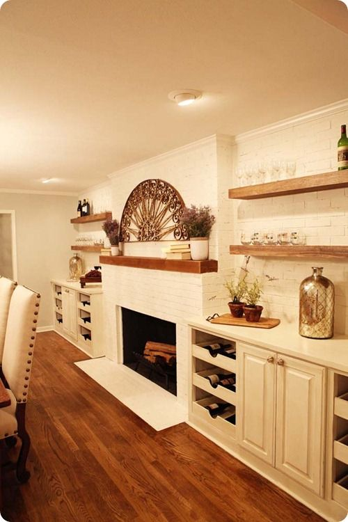 dining room wall built ins and raw wood shelves.  match mantle in family room to shelves.