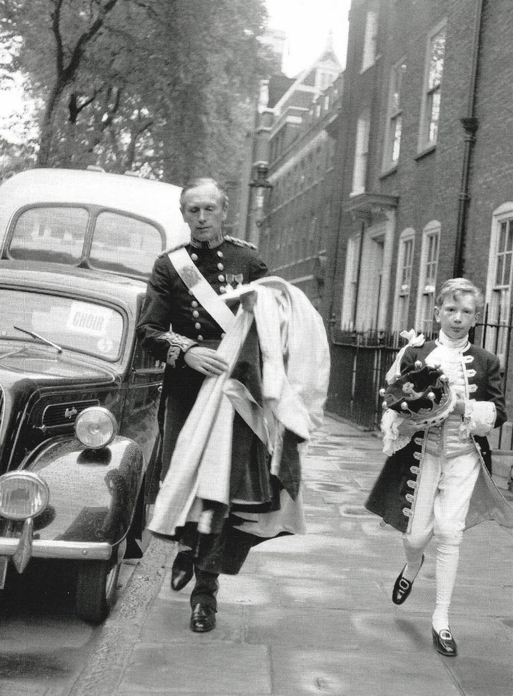This is the Earl of Home hurrying along Great College Street together with his page who I believe is his only son David Douglas-Home, now the 15th Earl of Home. They have an appointment at Westminster Abbey for the Coronation of Queen Elizabeth II on Tuesday 2nd June 1953. As Sir Alec Douglas-Home he was conservative Prime Minister from October 1963 to October 1964. This chap had more names/titles than many criminals I have known, originally known as Alexander Frederick Douglas-Home, then…