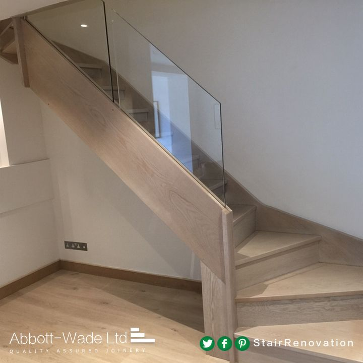 Abbott-Wade stained oak staircase with frameless glass balustrade.