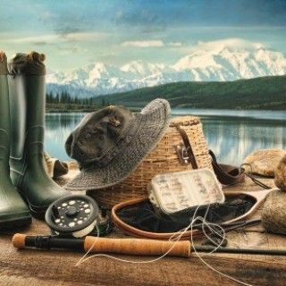 14832238-fly-fishing-equipment-on-deck-with-beautiful-view-of-a-lake-and-mountains