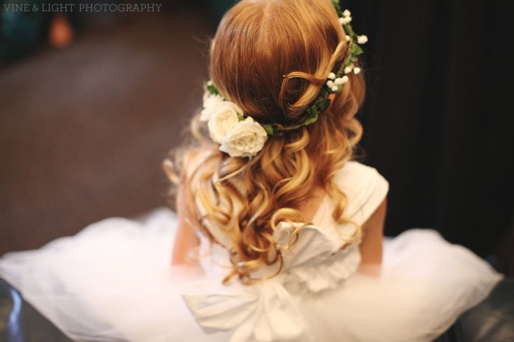 flower crown of bacopa greenery and white spray roses for the flower girl.