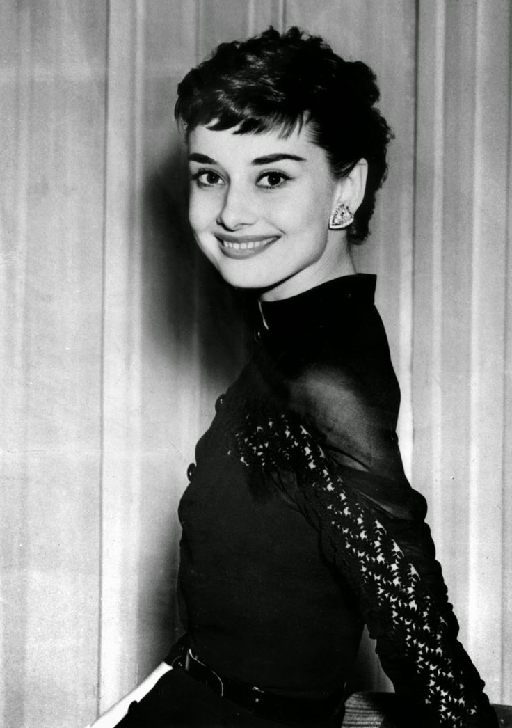 """Audrey Hepburn photographed during a cocktail offered specially for her (after a long stay in Rome, for the filming of """"Roman Holiday"""") at the Claridges Hotel in London (England), on May 21, 1953."""