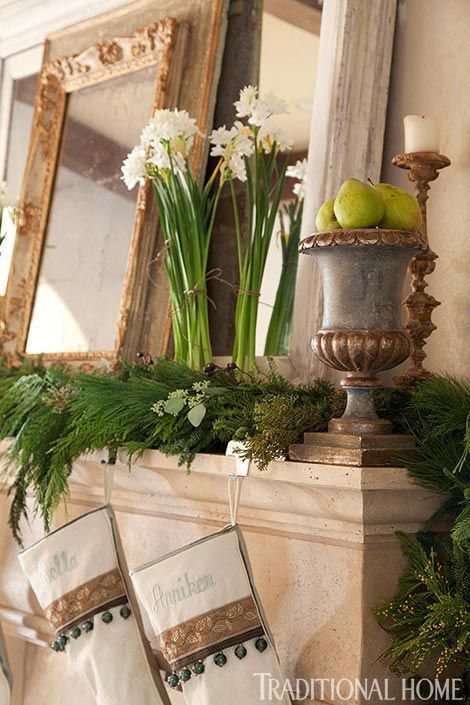 Paperwhite flowers add vertical interest to a holiday arrangement. - Traditional Home® / Photo: Emily Minton Redfield