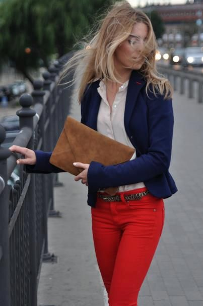 Navy blazer, white button up, red bottom (in this case skinny jeans), a touch of leopard (belt) and classic clutch in casual cognac.