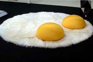 Fried egg rug with double yolk cushions http://www.myhomerocks.com/2012/02/wild-and-whimsical-rugs/