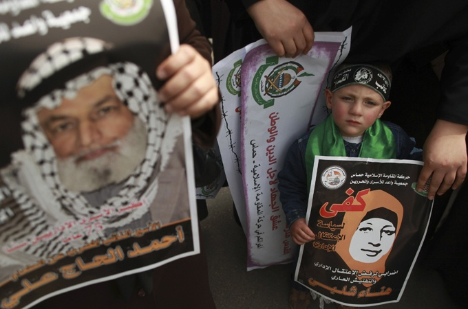A Palestinian boy holds a poster depicting Hana Shalabi during a Gaza City rallyIsraeli Palestinian Conflict, Depicting Hana, Boys Holding, Hanaa Shalabi, Prison Hanaa, Court Rejects, Cities Rally, Appeal Palestinian, Gaza Cities