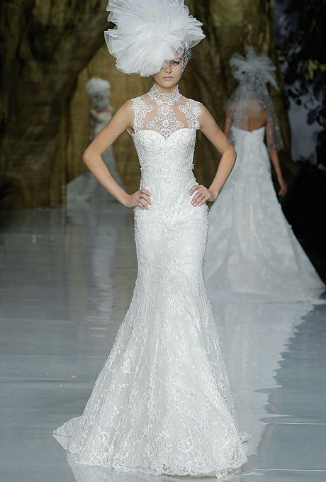 """Brides.com: Our Favorite Lace Wedding Dresses from the Bridal Runways. """"Yedira"""" sleeveless lace A-line wedding dress with a high illusion neckline and sweetheart bodice, Pronovias  See more Pronovias wedding dresses"""