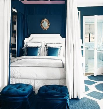 source: Mary McDonaldLove the painted pink ceiling! Royal blue elegnat girl's bedroom deisgn! Blue paint wall color. Love crisp white headboard, white bedding with blue stitching, silk blue Greek key pillows, upholstered tufted blue velvet ottomans, gold mirror, blue white geometric rug and canopy bed with billowy white panels!  blue white pink girl's room teen's room!