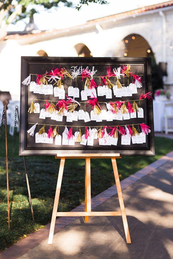tassel seating chart - photo by Ben Q Photography http://ruffledblog.com/whimsical-garden-wedding-in-dallas