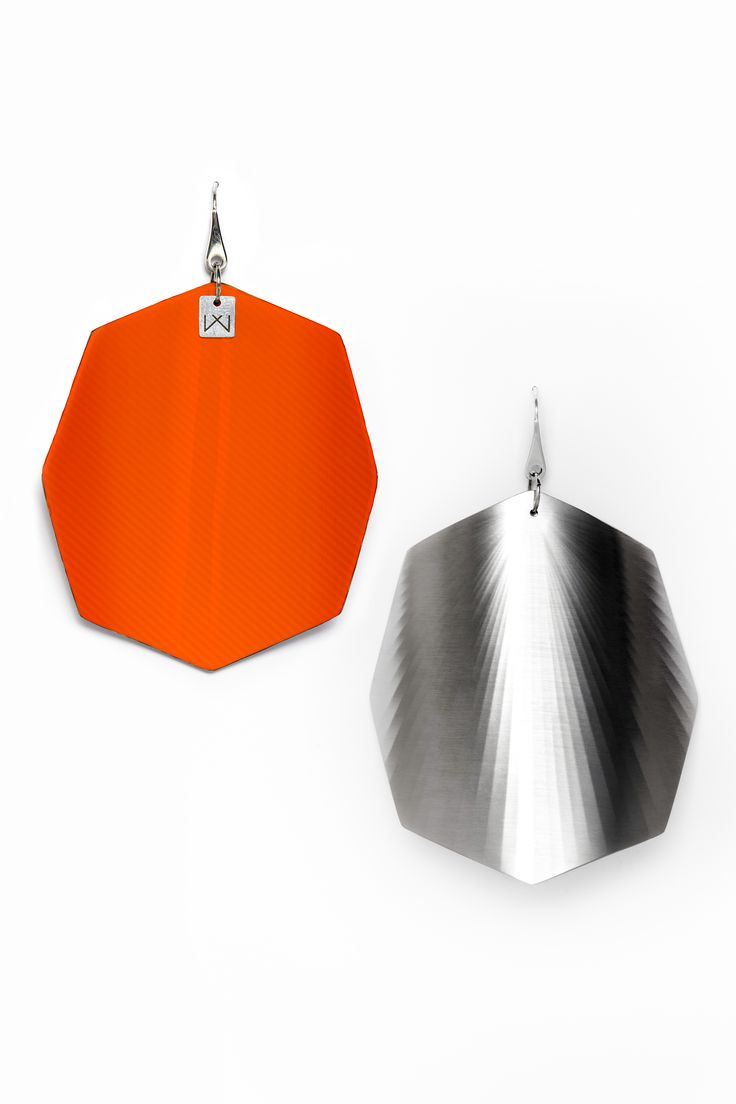 Vanda Ferencz rhodium pleated orange octagonal radial earrings with glass fiber.