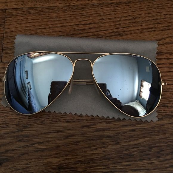 Ray ban Mirror Aviators Pre loved see the picture for small scratch on lens. They are Polarized so they were more expensive than the regular mirror aviators. Always get compliments on the silver lenses because everyone else usually has colored ones. Any questions just ask!  purchased at sunglass hut inside macys store. Ray-Ban Accessories Sunglasses.