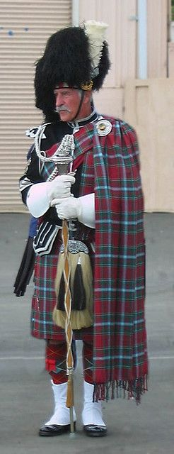 The drum major stands at attention while his pipe and drum corps performs at Ventura California Fairgrounds Highland games. Summer of 2006.