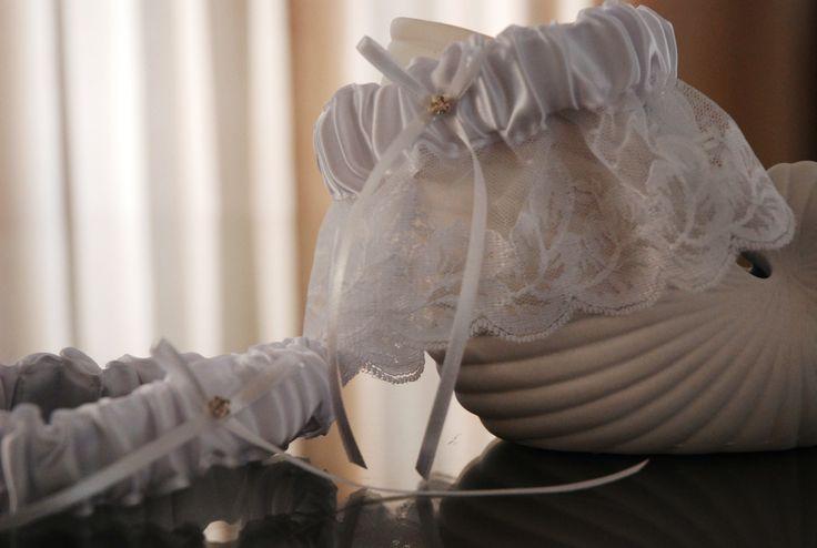 Main garter:  White satin and lace with white bow. Tossing garter:  White satin wth white bow. louise@heavenlygarters.co.za