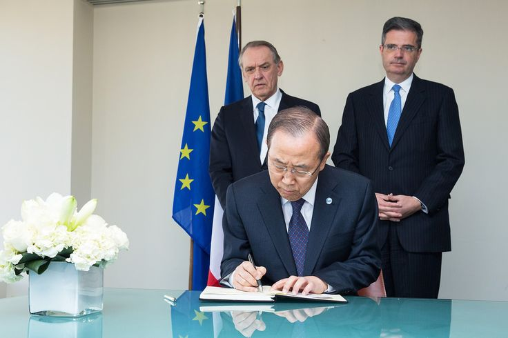 Secretary-General Ban Ki-moon signs a book of condolences at the Permanent Mission of France to the UN, on the loss of life during the 7 January terrorist attack against the Paris offices of the French magazine Charlie Hebdo. Twelve people were killed in the attack. Pictured behind Mr. Ban: Deputy Secretary-General Jan Eliasson (left) and François Delattre, Permanent Representative of France to the UN.  UN Photo/Evan Schneider 09 January 2015 New York, United States Photo # 618977