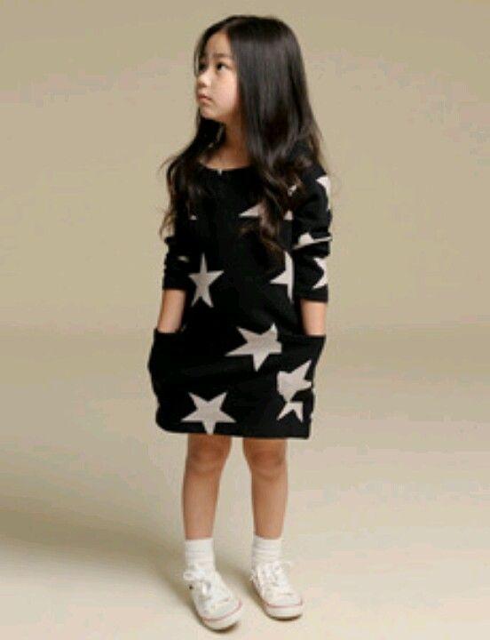 This NUNUNU Black Star Dress has long sleeves, raw edging, and Allover Star Print.
