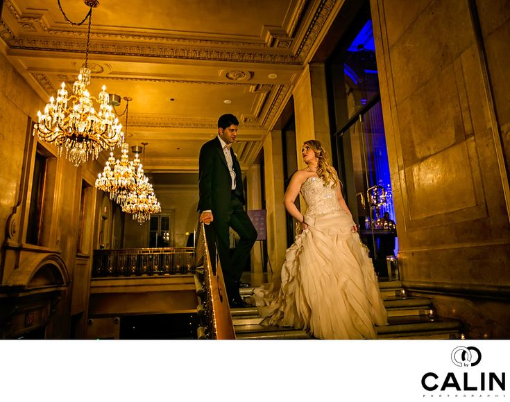 Photography by Calin - Artistic ONE KING WEST WEDDING PHOTOGRAPHY:   This image of the bride and groom taken at One King West is one of the best I have ever seen taken at the entrance to the Grand Banking Hall.&nbsp,  This splendid hotel&nbsp,has plenty of locations are appropriate for an indoor photo shoot. For this image, I asked the bride and groom to join me by the luxurious stairs in the lobby.&nbsp,  I placed the couple in such way so that we could admire both the magnificent…