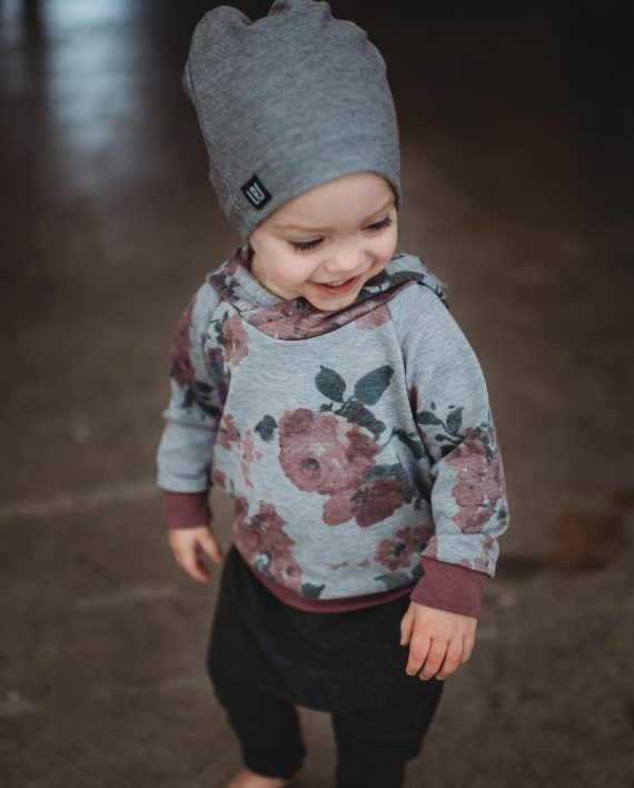 Beautiful watercolour floral with tones of pink and purple over a grey background. These hoodies have a modern slim fit and double layer hood with an overlapped neck. They hit at about the hip …