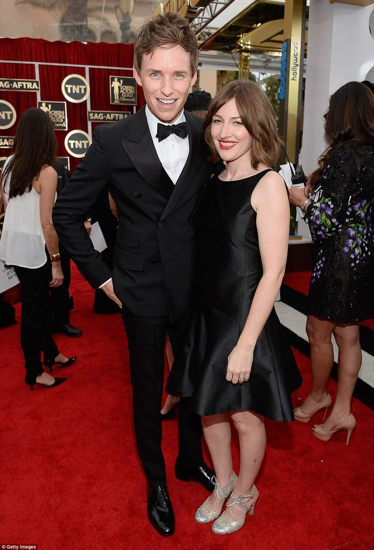 Old friends: Eddie Redmayne, SAG nominated for his portrayal of Stephen Hawking in The Theory of Everything, poses on the red carpet with fellow Brit, Boardwalk Empire's Kelly Macdonald