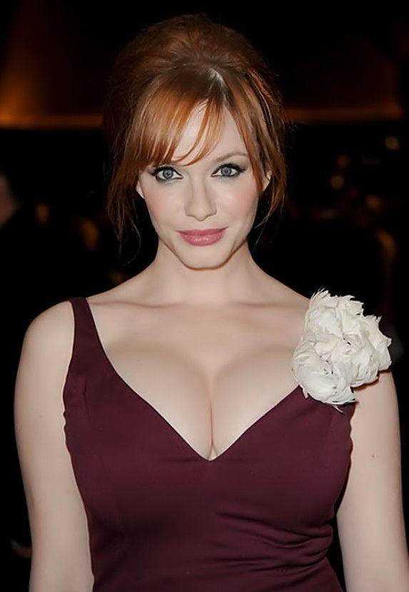 Redhead shows off massive tits