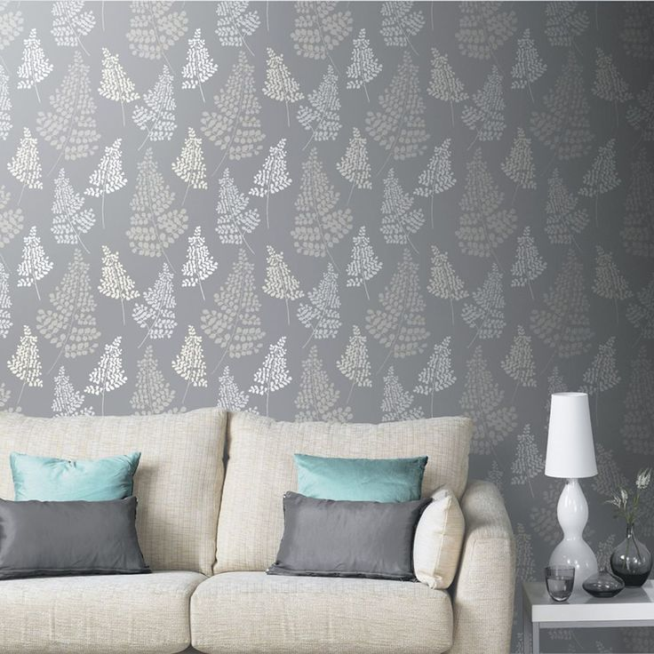 Arthouse Daybreak Wallpaper - Charcoal 891101  This beautiful Daybreak wallpaper features a pretty spring theme, with a delicate raised textured leaf pattern in ivory and pale grey tones infused with glitter particles, on a charcoal grey matte background. Easy to apply, this high quality wallpaper would look great as a feature wall or equally good when used to decorate a whole room. A beautiful leaf patterned wallpaper Features glitter highlights Ideal for feature walls or entire rooms…