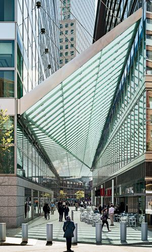 A glass-and-steel canopy by Preston Scott Cohen covers an alley between the Goldman Sachs headquarters by Pei Cobb Freed and the Conrad New York, a collaborative design effort.