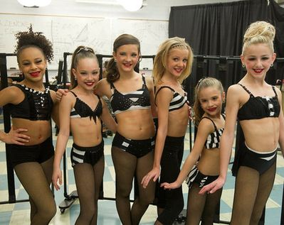 Season Two of Lifetime's hit reality TV show 'DanceMoms' girls before another competition. Nia Frazier (age 11), Madison Ziegler (age 9), Brooke Hyland (age 14), Paige Hyland (age 12), Mackenzie Ziegler (age 7), Chloe Lukasiak (age 11). (left to right) (they are currently 2-3 year's older now)