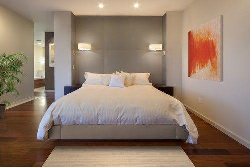 Schattierungen von grau an den Wänden werden stumm Kulisse, die diese Spritzer orange Kunst Stück abheben und füllen den Raum kahl aussehen macht. Foto von Phil Kean Designgruppe
