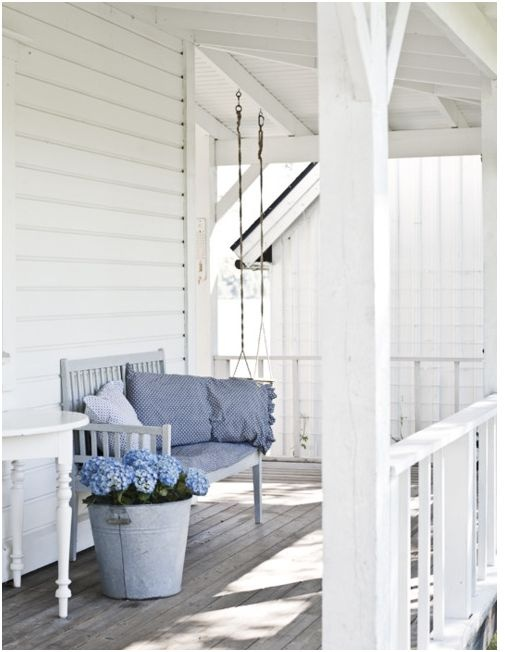 Lovely white porch with blue accent