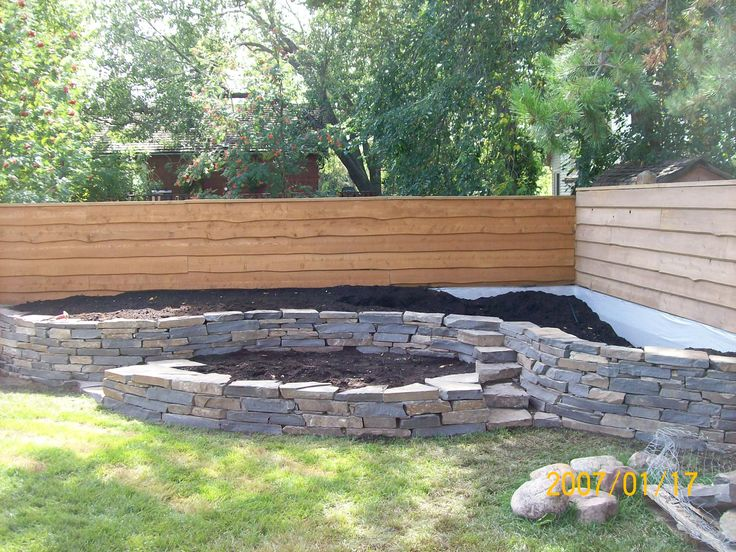 Raised Corner Vege Garden Against Fence : Stone walls, Natural stones and Landscaping on Pinterest