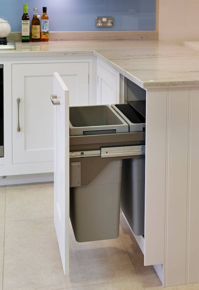 Our soft-close bin cupboard with recycling compartment. #kitchenstorage #kitchendesign