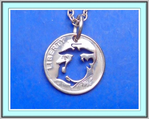 Here is a hand made Marine Corps emblem necklace cut from a Roosevelt dime. This coin will make a great charm or pendant for a marine…
