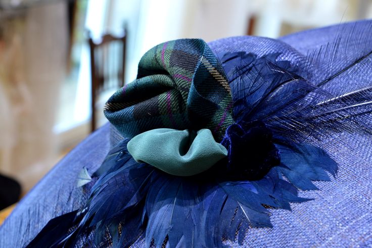 A stunning tartan trimmed french navy Mother of Bride hat