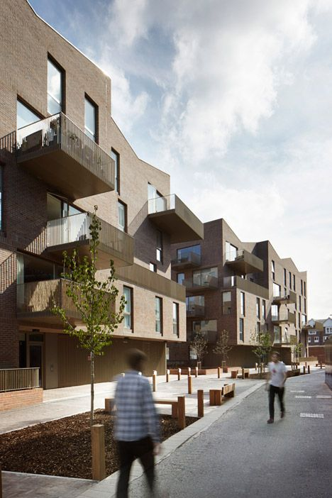 Simple brickwork and golden steel used for canalside housing.