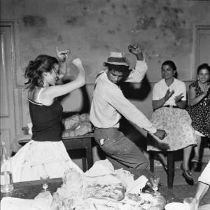 """Verbena de San Juan en la bodega Ca la Rosita, 1960.  From the  exhibition """"Jacques Léonard. Barcelona Gitana"""" in Arxiu Fotogràfic de Barcelona"""