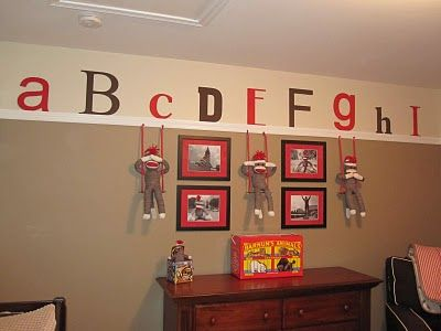 "Another view of the alphabet wall - LOVE the, ""hear/see/speak no evil"" sock monkeys hanging out."