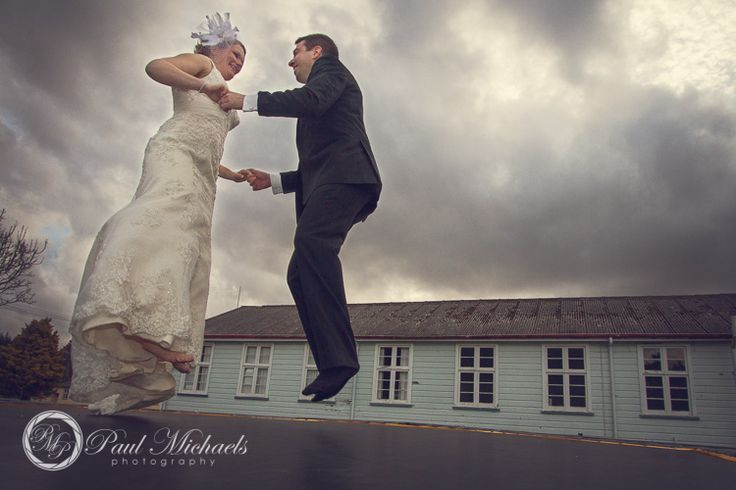 bride and groom fun on the trampoline. Wedding photography Wellington http://www.paulmichaels.co.nz/