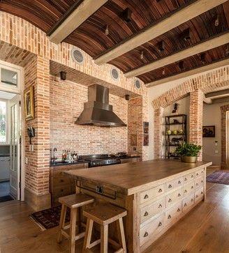 Mountain home kitchen, by Wynand Wilsenach Architects.