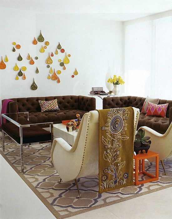 Chocolate brown sofas, teardrop ceramics, teardrop patterned throw pillows!!! So artsy and pretty!!! Love the dark colors